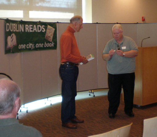 Author James D. Houston (left) receives a gift from DHPA President, Steve Lockart.